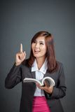 Asian business girl read a book come up with idea Royalty Free Stock Images