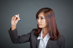 Asian business girl write in the air Royalty Free Stock Photos