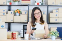 Asian business lady at office. Shot of Young, beautiful, Asian business lady, long black hair, wearing eyeglasses, in casual fashion, smiling, use bar code stock photos