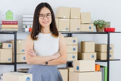 Asian business lady at office. Young, beautiful, Asian business lady, long black hair, wearing eyeglasses, in casual fashion sending cross arm with startup home stock photos