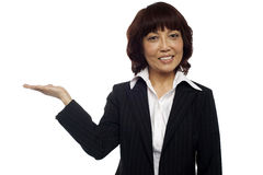 Asian business lady presenting copy space Stock Images