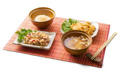 Asian business lunch 5. Asian business lunch with rice, miso soup, meat tempura, gedze and chopsticks on the matting over white background Royalty Free Stock Photos
