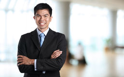 Asian business man with arms crossed. Stock Image