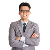 Asian business man arms folded. Portrait of Asian business man arms folded smiling, standing isolated on white background Stock Photography