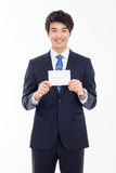 Asian business man with blank card. Royalty Free Stock Photos