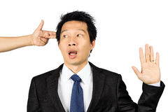 Asian business man bullied by a gun Stock Images