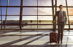 Asian business man carry suitcase smiling Royalty Free Stock Images