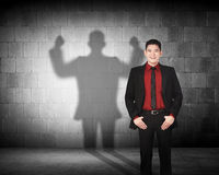 Asian business man casting a strong man shadow Royalty Free Stock Photography