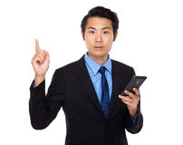 Asian business man with cellphone and finger up Royalty Free Stock Images