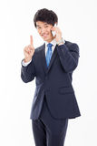 Asian business man with cellphone. Royalty Free Stock Image