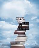 Asian business man climbing book Stock Images
