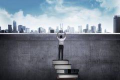 Asian business man climbing book Royalty Free Stock Images