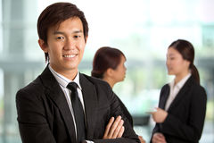 Asian Business man with colleague's in background Stock Images