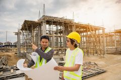 Asian business man construction engineer workers at building site Stock Photos
