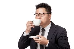 Asian business man drinking coffee Royalty Free Stock Images