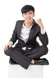 Asian business man feel free or exciting. Full length portrait squat and isolated on white background Royalty Free Stock Photography