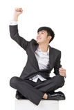 Asian business man feel free or exciting. Full length portrait squat and isolated on white background Stock Image
