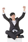 Asian business man feel free or exciting. Full length portrait squat and isolated on white background Stock Images
