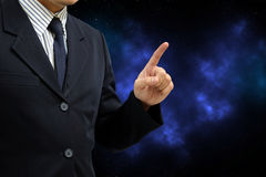 Asian business man finger point up on abstract galaxy background Royalty Free Stock Image