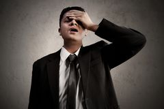 Asian business man forget expression. Asian business man forgetful expression Stock Image
