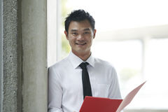 Asian Business man holding a folder Stock Images