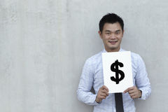 Asian Business man holding a $ sign. Stock Images