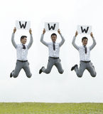 Asian business man jumping with a sign Royalty Free Stock Photos