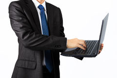 Asian business man with a laptop computer over white Royalty Free Stock Images