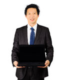 Asian business man with a laptop computer over white Royalty Free Stock Image