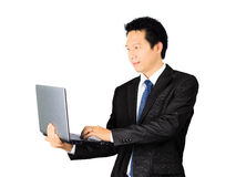 Asian business man with a laptop computer over white Stock Photo
