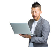 Asian business man look at laptop computer Royalty Free Stock Photos