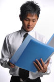 Asian Business Man Looking At File Royalty Free Stock Images