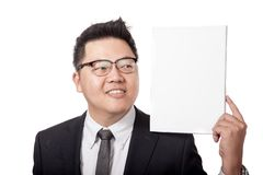 Asian business man looking at blank sign on his shoulder Stock Photography