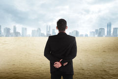 Asian business man looking the city on the desert Stock Images