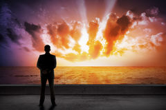 Asian business man looking the cloud on the sea Royalty Free Stock Image