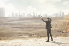 Asian business man looking at the destroyed city Stock Photo