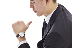 Asian business man looking at watch Stock Photos