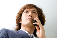 Asian business man and phone Royalty Free Stock Photos