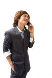 Asian business man and phone Royalty Free Stock Image