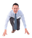 Asian business man on position ready to run. Asian business man on starting line of a race, front view full length isolated over white background Royalty Free Stock Photo