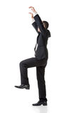 Asian business man pull up pose, full length portrait isolated o Royalty Free Stock Photos