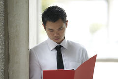 Asian Business man reading documents Royalty Free Stock Photo