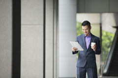 Asian Business man reading a newspaper. Royalty Free Stock Photography