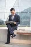 Asian Business man reading a newspaper. Stock Photography