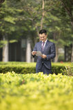 Asian Business man reading a newspaper. Royalty Free Stock Images