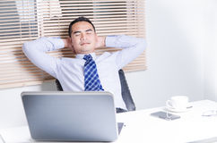 Asian business man relaxing close the eyes in work space. Asian business man relaxing close the eyes in office Royalty Free Stock Photos