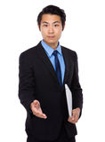 Asian business man shake hand with laptop Stock Image
