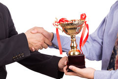 Asian business man shake hand and receive golden trophy stock photos