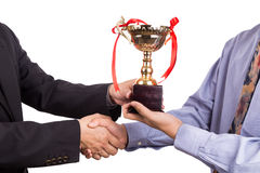 Asian business man shake hand and receive golden trophy stock photography