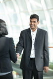 Asian business man shaking hands with a woman Royalty Free Stock Photos
